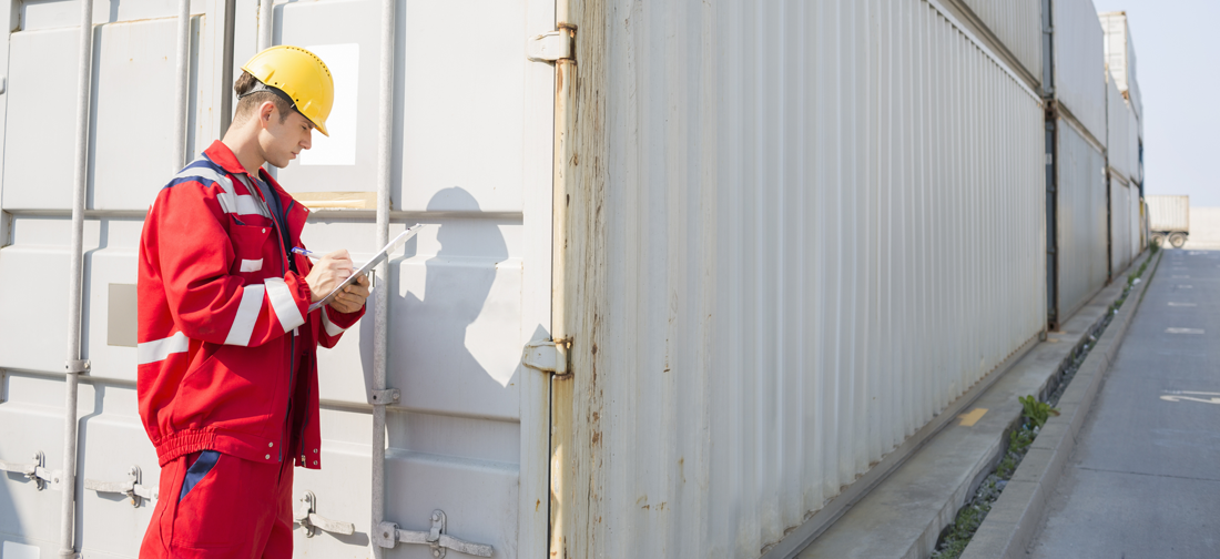 Worker Checking Cargo Container to Ensure There Has Been No High Value Goods Tampering