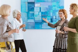 art collectors marveling at artwork